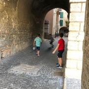 The sound of laughter as Italian boys played street soccer was musical